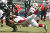 Bellaire #2 Kevin Reid forces a fumble on Austin #9 Byron Smith.