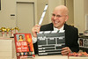 """Roger Leslie poses for a picture at the launching party of his latest book """"Film Stars and Their Awards""""."""