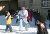 Brooke Lyles, librarian at Cloverfield Elementary School, ducks for cover as she gets attacked with snowballs from her 1st graders. <br /> 15 tons of snow was brought to the school. It is part of a reward program that the school did for students who has accumulated more than 10000 points for reading this semester. That averages about 15 books. The school has checked out more than 8000 books from the library thus far.