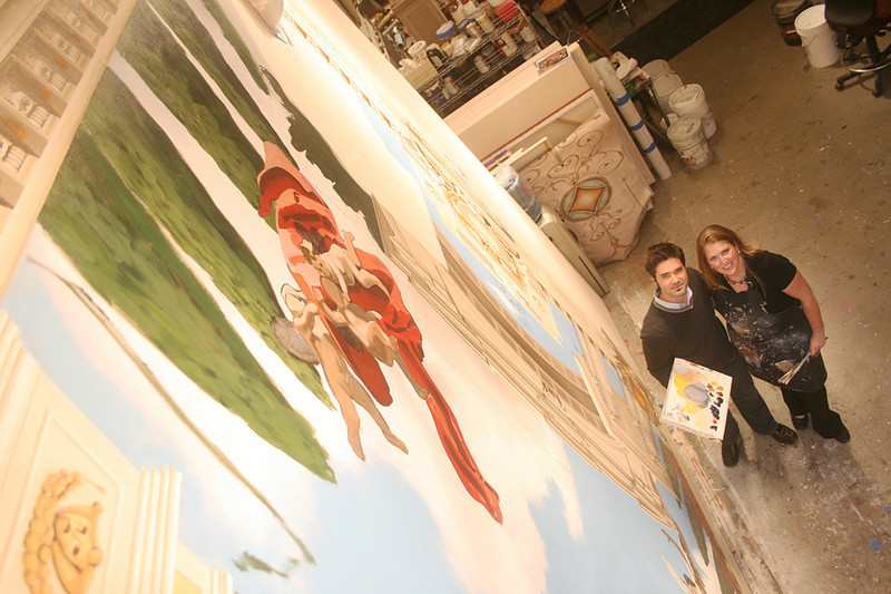 Jeremy and Jaime Wells pose for a photo at the studio gallery, Imago Dei.