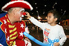 Happy The Clown lets a young fan touch his nose at the 14th Annaul Toys For The Kids Holiday Celebration at the GRB Convention Center.