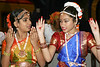 2 young dancers from Anjali Center for Performaning Arts Indian Dances, runs over some gestures before their performance at the 14th Annaul Toys For The Kids Holiday Celebration at GRB Convention Center.