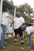 Lindsey Bunting and Magarita Perez helps Steffon Kendrick clear away ants on his arms and legs.<br /> ARAMARK employees volounteered to will help remodel and repair several homes in the Sunnyside/South Park neighborhoods, including the home of Ms Lorene Bell.