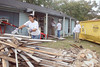 Margarita Perz clears away pieces of rotting wood taken out of the house.<br /> ARAMARK employees volounteered to will help remodel and repair several homes in the Sunnyside/South Park neighborhoods, including the home of Ms Lorene Bell,