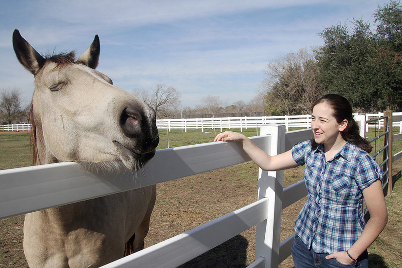 Jen bonding with one of the horses at Red Dun Ranch.