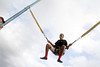 10th grader Daeshaun Lewis on the Bungee Trampoline at Pearland High School's annual Oilerfest. Photo by Pin Lim.