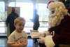 Gage (4) gives his wish list to Santa at the Pasadena Post Office.