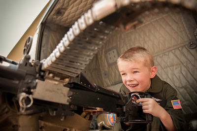 Gavin Collins, 5 1/2 years old, Indianapolis in Huey 369 at the  American Huey 369 organization's  5th Annual Gathering of Our Veterans and All Patriots Grissom Aeroplex, Peru, IN, Aug. 13. Ron Paye, granddad, co-pilot.