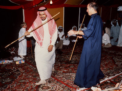 Prime Minister Pierre Trudeau takes part in a classical Arabic dance with Saudi Arabian oil minister Sheikh Zaki Yamani November 19, 1980, during a trip to the Middle East. (CP PHOTO/Fred Chrantrand)