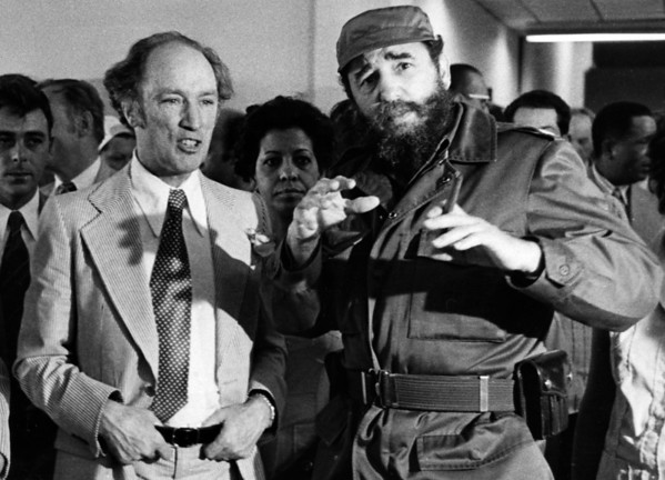 (CPT5-Apr.19)--TRUDEAU IN CUBA--Former prime minister Pierre Trudeau looks on as Cuban President Fidel Castro gestures during a visit ot a Havana houising project in this Jan. 27, 1976 photo. Prime Minister Jean Chretien will visit Cuba at the end of the month, making him thefirst Canadian prime minister since Trudeau to visit the Caribbean communist country. (CP PHOTO) 1998 ( Staff-Fred Chartrand)