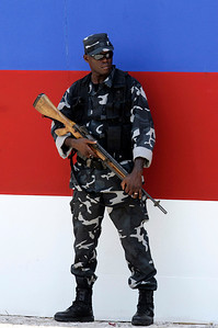 A Haitian policeman guards the platform during President Rene Preval's inauguration address at the National Palace in Port-au-Prince, Haiti  SundayvMay 14, 2006.(CP PHOTO/Fred Chartrand)