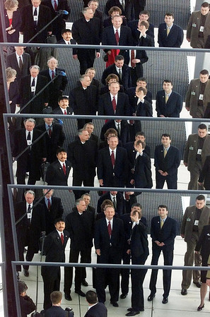 Prime Minister Jean Chretien and members of Team Canada and delegation are reflected in a sculpture as they they tour the Reichstag in Berlin, Germany, Monday Febuary 18, 2002. (CP PHOTO/Fred Chartrand)