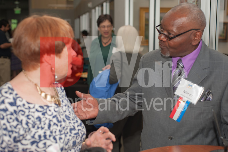 Milton Whitley, on the right, discusses the events of the 50 year celebration for the Literacy Council of Montgomery County with an unidentified participant.