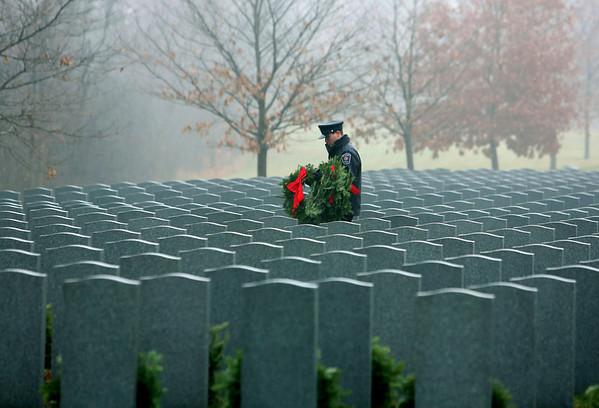 An Ottawa firefighter carries wreaths to place at headstones of fallen soldiers during a Wreaths Across Canada ceremony at Beechwood Military Cemetery in Ottawa, Sunday December 2, 2012. The commemorative ceremony has chosen to place a wreath on the headstone of every veteran buried in the National Military Cemetery, the first Sunday of every December at 1:30, Beechwood Cemetary, Ottawa. THE CANADIAN PRESS/Fred Chartrand