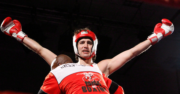 Liberal MP Justin Trudeau celebrates after he defeated Conservative Senator Patrick Brazeau during charity boxing match for cancer research Saturday, March 31, 2012 in Ottawa . THE CANADIAN PRESS/Fred Chartrand