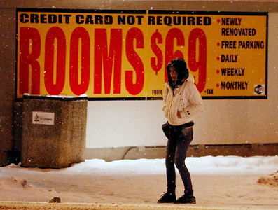 Ottawa sex trade workers say aggressive policing drives them into dangerous situations. A woman walking in -15 temperatures on Montreal Rd, near Hannah street in Vanier, Wednesday evening, January 4,2012. For the Globe and Mail/Fred Chartrand photo