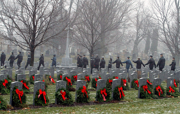Cadets march past wreaths and headstones during a Wreaths Across Canada ceremony at Beechwood Military Cemetery in Ottawa, Sunday December 2, 2012. The commemorative ceremony has chosen to place a wreath on the headstone of every veteran buried in the National Military Cemetery, the first Sunday of every December at 1:30.THE CANADIAN PRESS/Fred Chartrand