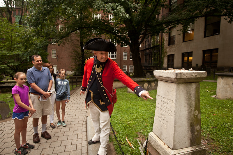 8/25/15 Boston, Mass. -- Historian Michael Szkolka, dressed as a soldier in the First Regiment of the Foot Guards leads a walking tour through the Granary Buring Ground, a stop along the freedom trail in Boston, Mass. August 24, 2015. Erik Jacobs for the New York Times