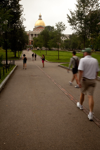 8/25/15 Boston, Mass. -- Pedestrians walk along the Freedom Trail (indicated by the red brick line) toward the state house in Boston, Mass. August 24, 2015. Erik Jacobs for the New York Times