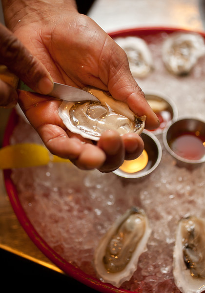8/25/15 Boston, Mass. -- Oysters being shucked at Row 34 in Boston, Mass. August 24, 2015. Erik Jacobs for the New York Times