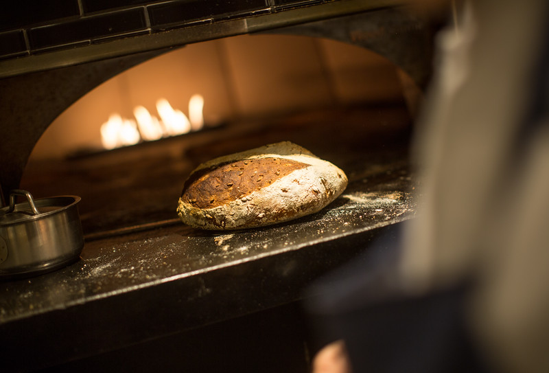 12/28/16 Concord, Mass. -- Rye flour sourdough with sprouted rye berries coming out of the oven at Bondir in Concord, Mass. December 28, 2016. Erik Jacobs for the New York Times