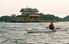 7/26/08 Jamestown, RI -- A kayaker glides past Clingstone, built in 1905 and currently owned by Henry Wood, located in Narragansett Bay, RI.  July  26, 2008.  Erik Jacobs for the New York Times <br /> 30065452A