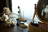7/26/08 Jamestown, RI -- Desktop collectables in a bedroom at Clingstone, built in 1905 and currently owned by Henry Wood, located in Narragansett Bay, RI.  July  26, 2008.  Erik Jacobs for the New York Times <br /> 30065452A