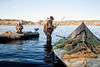 11/7/09 Rochester, MA -- Paul Hunt loads a Beretta Xtrema2 into his boat after a duck hunt in Snipatuit Pond in Rochester, MA November 7, 2009.  Erik Jacobs for the New York Times 30088017A