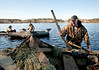 11/7/09 Rochester, MA -- Paul Hunt loads a  TriStar Hunter Mag into his boat after a duck hunt in Snipatuit Pond in Rochester, MA November 7, 2009.  Hunt was using a Beretta Xtrema2.  Erik Jacobs for the New York Times <br /> 30088017A