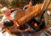 10/11/10 Phillipston, MA -- Benita Gold, Mateo Gold, 7, and Frank Rudy Schaeffer hang out in their wood-fired hot tub at home in Phillipston, Mass. Oct. 11, 2010.  Erik Jacobs for the New York Times