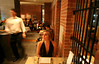 9/8/07 Boston, MA -- Rachel Pachivas orders dinner during her first visit to the CLINK bar and restaurant at the Liberty Hotel in Boston, MA, September 8, 2007.  Erik Jacobs for the Boston Globe