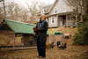 1/17/08 Chilmark, MA -- Portrait of Jan Buhrman, with her chickens in front of their mobile chicken house in Chilmark, MA.  Buhrman tries to only eat what is locally produced on Martha's Vineyard, where she lives year-round.  January, 17 2008.  Erik Jacobs for the New York Times