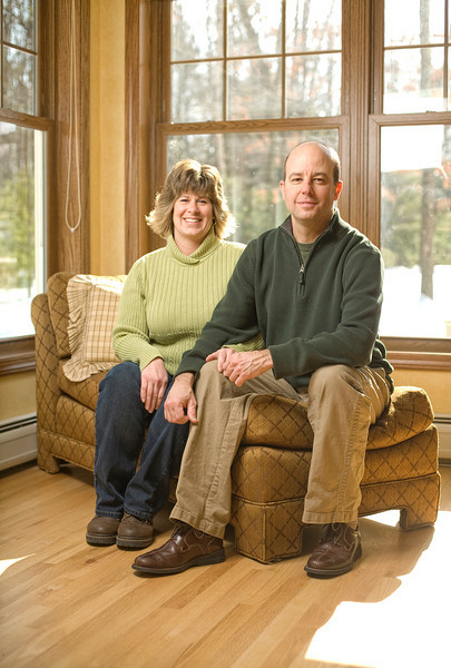 2/6/09 Nashua, NH -- Portrait of Brian and Beth Lowe at their home in Nashua, NH February 6, 2009. Beth and Brian met as children at Lake Naomi, a resort community in the Poconos where their families owned vacation homes, and where the Lowes now bring their own two son.  Erik Jacobs for the New York Times <br /> 30075914A