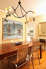 """9/28/09 Middletown, RI -- The dining room at the home of Maryalice Huggins in Middletown, RI September 28, 2009.  At the left is a painting by Huggins' sister, Susan Huggins.  Maryalice Huggins is an author and furniture refinisher who fell in love with an American Rococo Revival mirror from the 1830's, bought it at auction and wrote a book about it called, """"Aesop's Mirror: A Love Story.""""  Erik Jacobs for the New York Times <br /> 30085759A"""