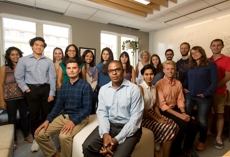 7/7/16 Cambridge, Mass. -- Portrait of Roland Fryer with his team of student researchers who have published surprising results from a new study on police shootings and brutality.  Photo by Erik Jacobs for the New York Times