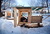 "2/16/11, Stoughton Mass. -- Derek Diedricksen demonstrates how one might use the ""Boxy Lady,"" a single sleeper and mobile vending kiosk, one of four homemade structures at his home in Stoughton, Mass. February 16, 2011.  Erik Jacobs for the New York Times"