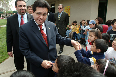 US Attorney General Alberto Gonzalez greets children at the Windmill Elementary school in San Jose, Ca.