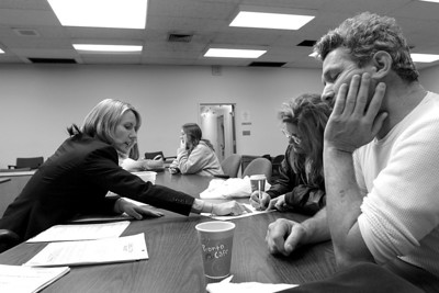 Kimberly Merrifield (left) is a part-time attorney hired by the state to help with its Self-Help Assistance & Referral Program. Tim Hogan, 49, has a fifth grade education and is getting help from his girlfriend Nancy Ellsworth, 44, filling out the paperwork during a marriage dissolution workshop held in Oroville.