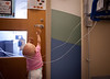 8/25/11 Boston, Mass. --  Despite her chemotherapy treatments, 14-month-old Saoirse Fitzgerald (whose name means 'freedom' in Gaelic) reaches for a locked playroom door ready to play at Children's Hospital Boston, August 25, 2011.  On this particular day, Mike Fitzgerald estimated that Saoirse was operating at about 60-70 percent her normal capacity.