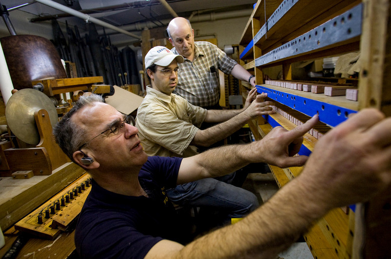 5/2/09 Medford, MA -- From left, volunteers with the Chevalier Theatre Organ Society, Dick Pelland, Chris Desautels and Michael Cerullo do work on the main chest of a Wurlitzer theatre organ at the Chevalier Theatre in Medford, Mass. May 2, 2009.  Erik Jacobs for the Dayton Daily News