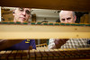 5/2/09 Medford, MA -- From left, volunteers with the Chevalier Theatre Organ Society Dick Pelland and Michael Cerullo do work on the main chest of a Wurlitzer theatre organ at the Chevalier Theatre in Medford, Mass. May 2, 2009.  Erik Jacobs for the Dayton Daily News