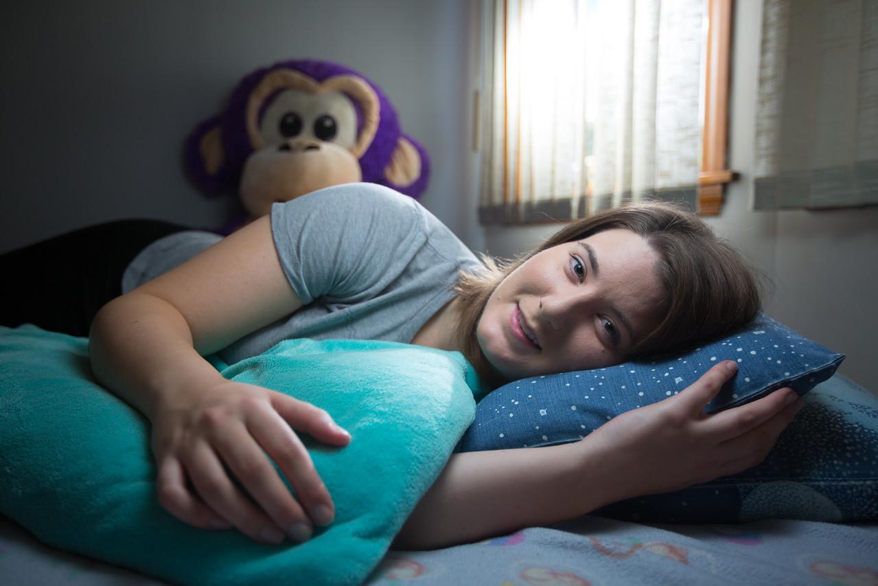 9/24/16 Medford, MA -- Portrait of professional cuddler Samantha Varnerin in her bedroom in Medford, Mass. September 24th, 2016.  Erik Jacobs for Penny Hoarder