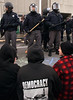 Ottawa police wearing roit gear and sticks hold a standoff with protesters holding a sit-in on a street outside the National Defence headquarters in Ottawa Friday morning Nov. 12, 1999. Over 50 people were arrested after they blocked a bridge during a homelessness protest.(CP PHOTO/Fred Chartrand)