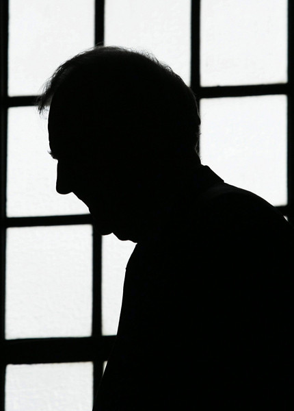 Prime Minister Paul Martin is silhouetted against a window as he makes his way to his office after attending Question Period in the House of Commons in Ottawa, Tuesday, October 18, 2005.(CP PHOTO/Fred Chartrand)