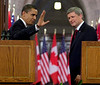 U.S.President Barack Obama waves to the media as he and Prime Minister Stephen Harper leave a joint news conference on Parliament Hill in Ottawa, Thursday Feb.19, 2009. THE CANADIAN PRESS/Fred Chartrand