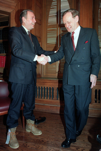 Finance Minister Paul Martin shakes hands with Prime Minister Jean Chretien in Ottawa, Feb.21, 1994, in this pre budget photo. (CP PHOTO/Fred Chartrand)