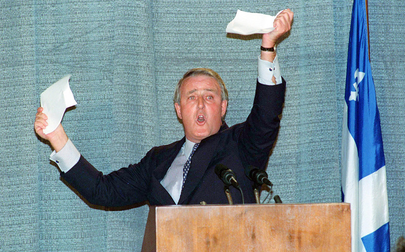 HiRes (SHER1) SHERBROOKE, Quebec, Sept 28--RIPS PAPER--Prime Minister Brian Mulroney holds up a piece of paper he had torn during a speech in Sherbrooke, Quebec, Monday.  Mulroney was demonstrating that a No vote on the referendum would rip apart the 31 points Quebec got in the Charlottetown agreement.  (CP PHOTO) 1992 (stf-Fred Chartrand)