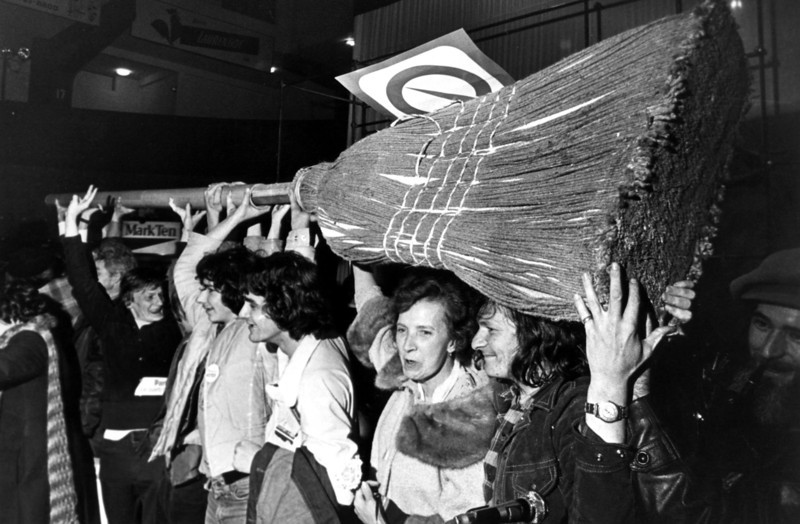 Joyous Parti Quebecois supporters carry a giant broom through the streets of Montreal Nov. 15, 1976, during a hoopla following the Parti Quebecois upset victory over the Liberals the night before. (CP PHOTO/Fred Chartrand)