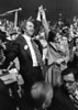 This is a file photo of Joe Clark, and his wife Maureen McTeer, raising their arms in acknowledgement as delegates to the Progressive Conservative convention cheer Clark's victory in the leadership race, February 22, 1976. (CP PHOTO) 1976 (stf-Fred Chartrand)