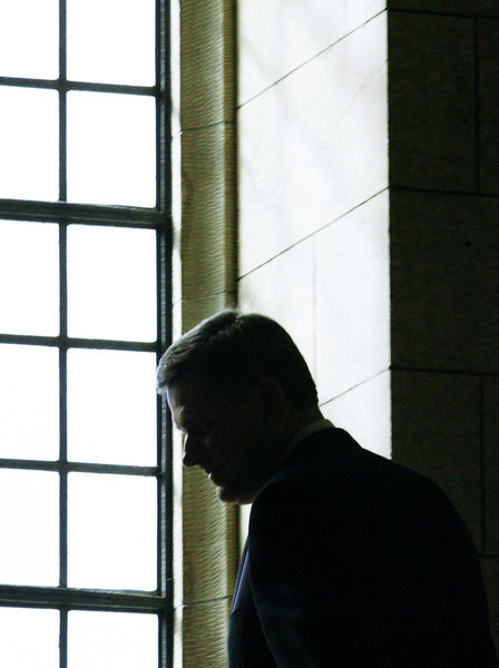 Prime Minister Stephen Harper is silhouetted as he makes his way to his office after holding a news conference to annouce that Federal Court Judge Marshall Rothstein will become the next Supreme Court Justice in Ottawa, Wednesday, March 1, 2006.(CP PHOTO/Fred Chartrand)